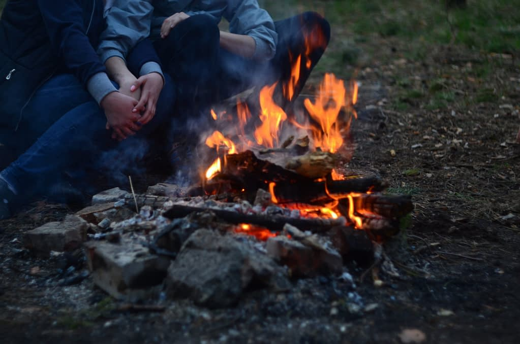 A campfire dinner by the lake at the end of a valentines day can make the date all that much more memorable.