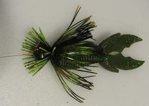 A creature or craw plastic bait will provide an excellent trailer for a skirted jig presentation.